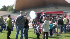 Family people enjoy fire man shoot with water cannon. 4K Stock Footage