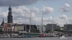 4K Famous Hamburg cathedral tower church boat traffic old port Elbe River day Stock Footage