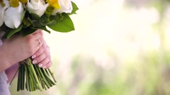 Bride smell the bouquet - stock footage