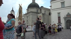 people walk in christian religious procession main city street. 4K - stock footage