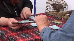 Woman pull tarot cards from fortune teller hands and fat rat in cage. Stock Footage