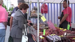 People buy fresh smoked beef sausage in city market . 4K Stock Footage