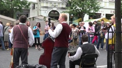Stock Video Footage of tourist and citizen people enjoy folk band play music. 4K