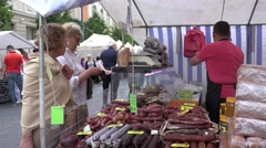 Customer woman buy fresh smoked meat products from man in eco store. 4K Stock Footage