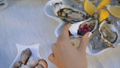 Pouring red souce on the oysters. Stock Footage