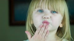 The little cute girl sends an air-kiss to the camera Stock Footage