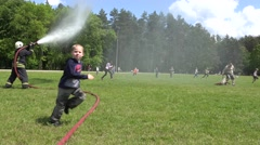 Stock Video Footage of People refresh under water from fireman hose. 4K
