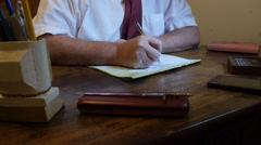 Man filling his calendar agenda in his office desk Stock Footage