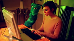 Woman talking to puppet on computer Stock Footage
