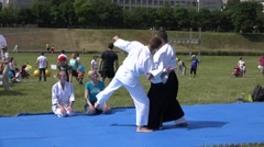 Master of martial arts train follower man in front of people audience. 4K Stock Footage