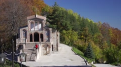 Christian temple in the mountains in autumn Stock Footage