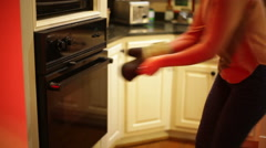 Getting pie out of oven Stock Footage
