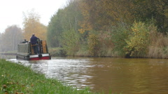 Canal narrow boat in autumn Stock Footage
