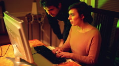 Man and woman looking couple computer search Stock Footage