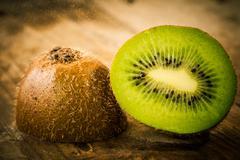 Ripe kiwi on wooden table close-up - stock photo