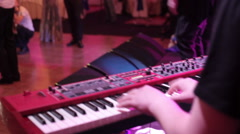 Keyboardist plays synthesizer in concert Stock Footage