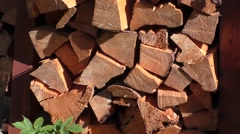 Dry firewood neatly folded and waiting for winter Stock Footage