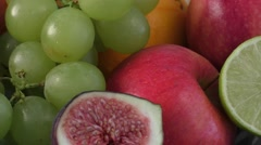 Assortment of exotic fruits on wooden table - stock footage