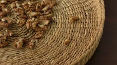 Walnut kernels in basket and whole walnuts Stock Footage