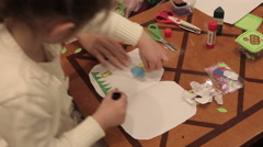 Children make appliques from paper Stock Footage