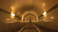 4K POV Point of view alight tunnel Hamburg city classical walk bike pass walkway - stock footage