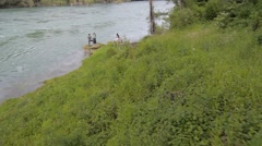 Stock Video Footage of Four young people enjoying on the small river