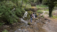 Four young people enjoying on the small river - stock footage