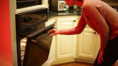 woman  checking oven opening - stock footage