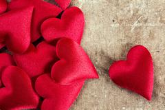 Hearts on old canvas background - stock photo