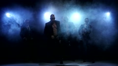 Night club dancers, man and woman posing in studio, smoke Stock Footage