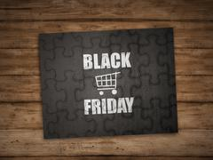 Black friday writing on puzzle - stock photo