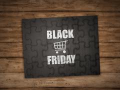 Black friday writing on puzzle Stock Photos