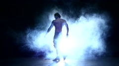 Full length silhouette of a young man dancer, smoke Stock Footage