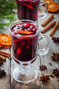 Stock Photo of homemade mulled wine with orange slices, cranberries, cinnamon and anise