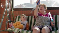 Stock Video Footage of Boy and Grandmother Playing with Soap Bubbles