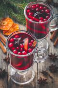 Homemade mulled wine with orange slices, cranberries, cinnamon and anise Stock Photos