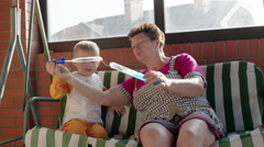 Stock Video Footage of Grandmother Helping Boy in Blowing Soap Bubbles