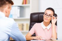 Female executive admires her office mate Stock Photos