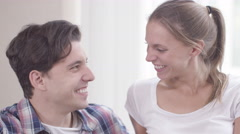 4K Portrait of happy young couple at home making a heart shape with their hands. - stock footage