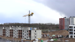 Workers with crane unload concrete house parts from trailer. 4K - stock footage