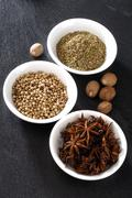 Pepper, anise on a dark background, spices Stock Photos