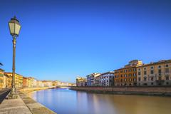 Pisa, Arno river, lamp and buildings reflection. Lungarno view. Tuscany, Ital - stock photo