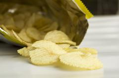 Potato chip fat cholesterol salted junk fast food concept Stock Photos