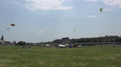 Various kites fly high in sky in city center. Kite control competition. 4K Stock Footage