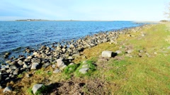 Shallow limestone shore with grass Stock Footage