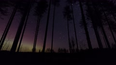 4K Time-lapse of stars moving in the sky with nordic lights in the horizon Stock Footage