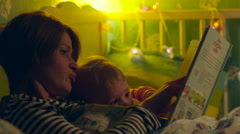 Mother Reading Bedtime Story to the Son - stock footage