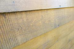 Rough pine boards of a modern wood house wall Stock Photos