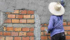 Labor Working Plaster Wall In Construction Site Stock Footage