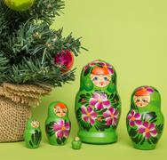 Russian wooden dolls around a Christmas tree Stock Photos